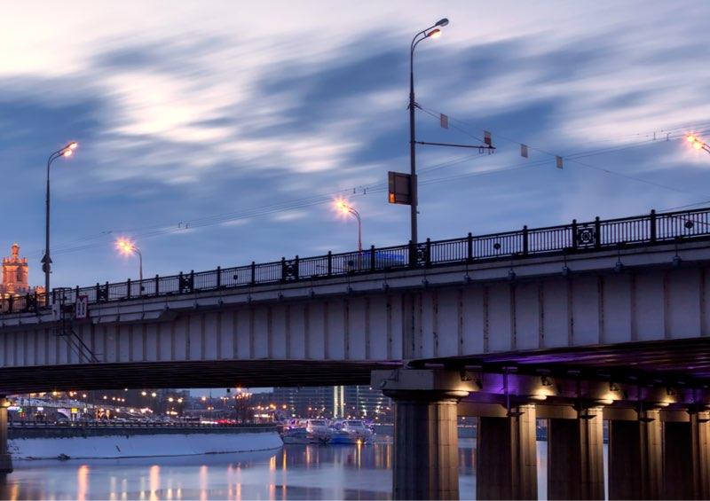 Street lights at dusk over a Beam style bridge